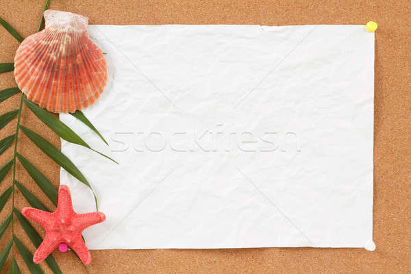 empty board with blank crumpled paper, seashells, palm leave and seashell Stock photo © artush
