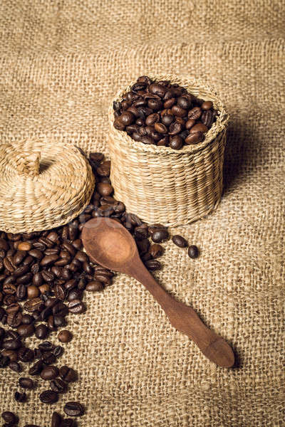 pile of fresh and bio aromatic coffee beans and spoon and jar Stock photo © artush