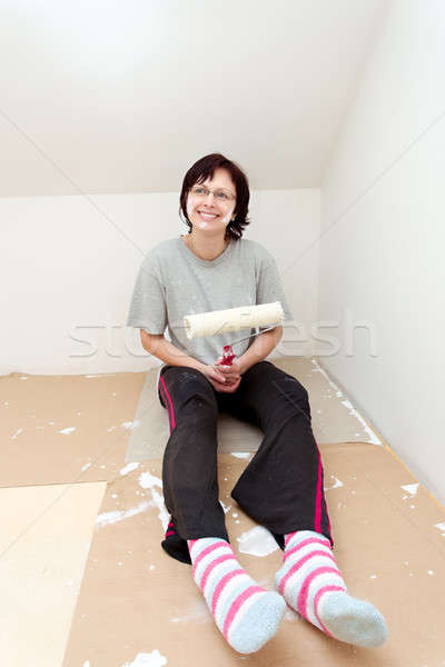 housewife resting after painting wall to white Stock photo © artush