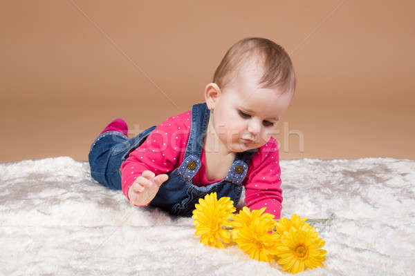 small infant baby with yellow flowers Stock photo © artush