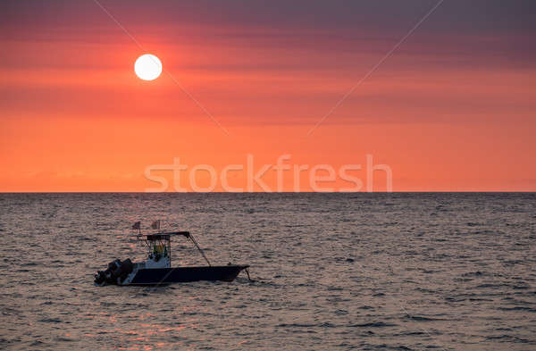 Sunset over Madagascar Nosy be beach with boat silhouette Stock photo © artush