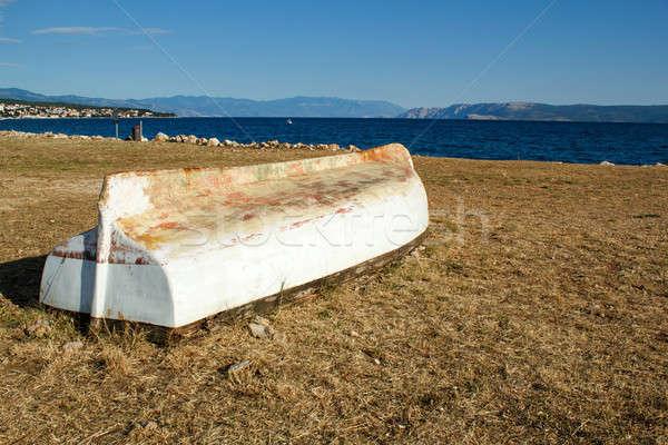 old boat stranded on stone beach Stock photo © artush
