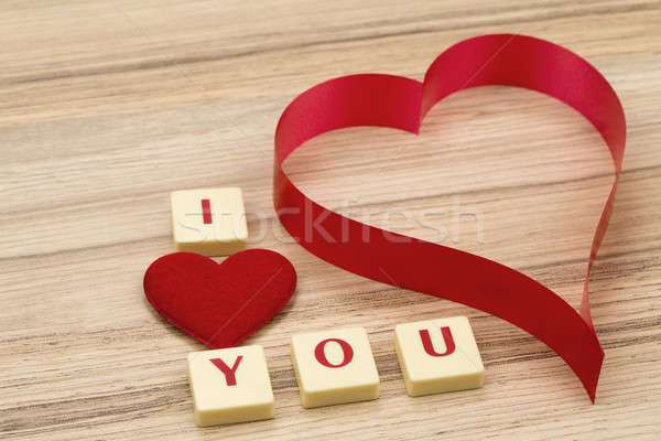 valentine's paper hearts on a wooden background and tex i love you Stock photo © artush