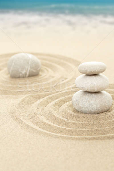 Balance zen stones in sand with sea in background Stock photo © artush