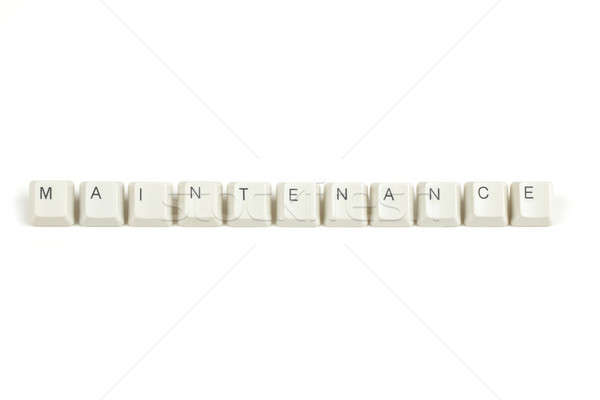 maintenance from scattered keyboard keys on white Stock photo © artush