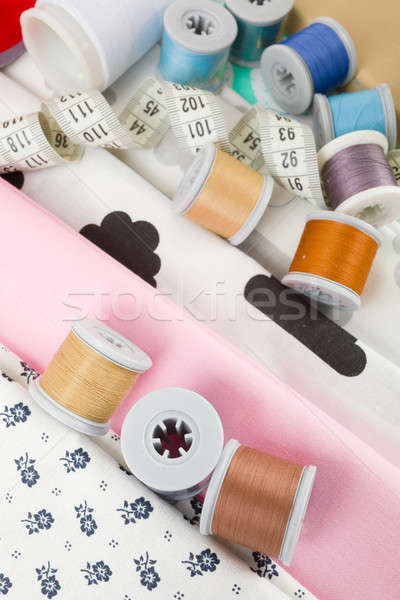 fabric, tailor measurement tape and thread spools Stock photo © artush