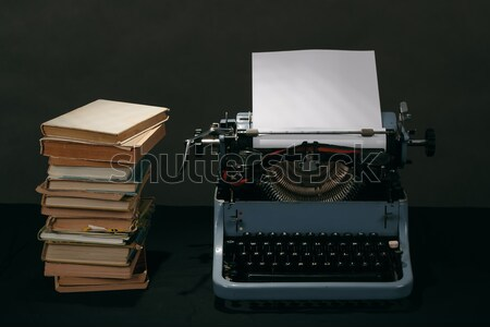 retro typewriter with stack of book and one opened book  Stock photo © artush