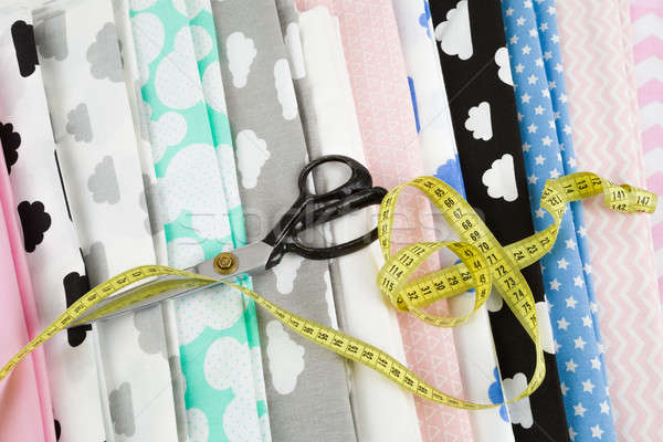 Stock photo: cotton fabric material, tailor measurement tape and scissors