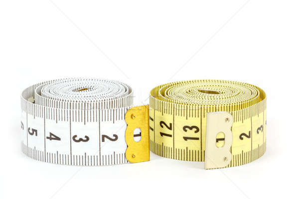 Yellow and white measuring tape isolated on white Stock photo © artush