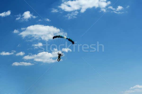 unidentified skydiver on blue sky Stock photo © artush