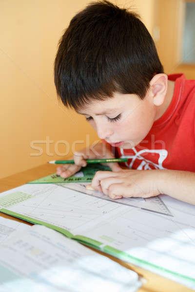 мальчика школы домашнее задание математика геометрия рабочая тетрадь Сток-фото © artush