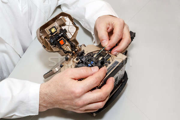 working with fiber optic fusion splicer Stock photo © artush