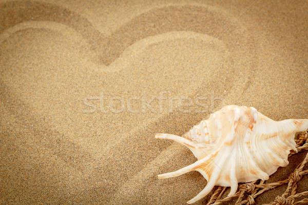 handwritten heart on sand with seashell and shallow focus Stock photo © artush