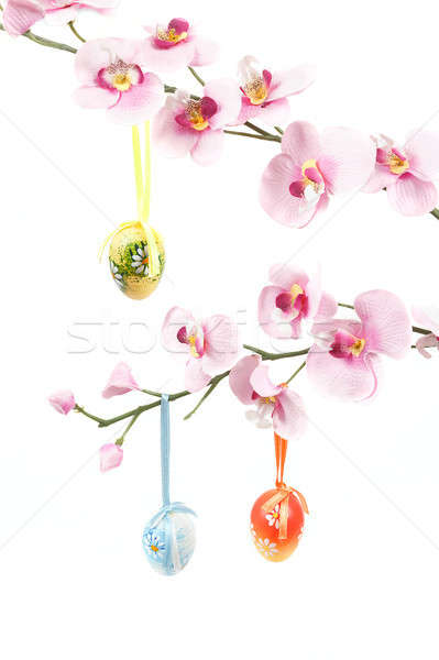 hanged bright color easter eggs with bows on spring flower Stock photo © artush