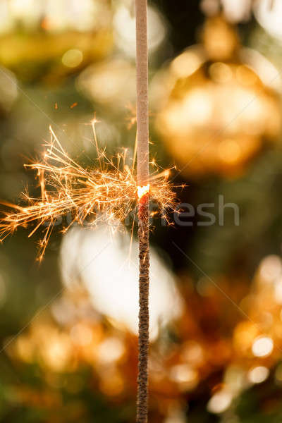 burning sparkler and out of focus christmas tree  Stock photo © artush
