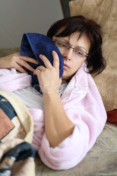 woman at home after pulling teeth Stock photo © artush