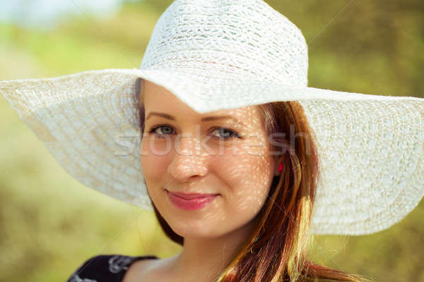 Portrait of cheerful fashionable woman in stylish hat Stock photo © artush