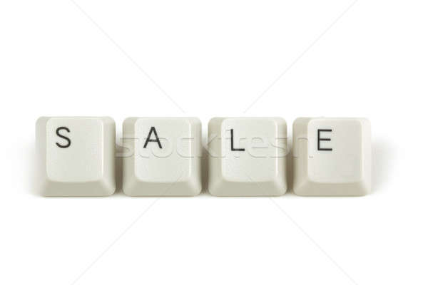 sale from scattered keyboard keys on white Stock photo © artush