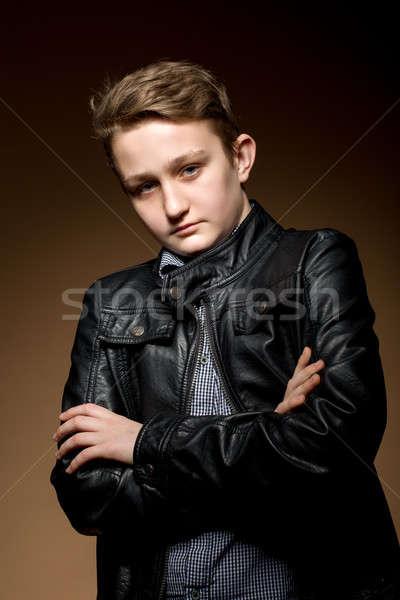 Portré jóképű megnyerő fiatalember sötét bézs Stock fotó © artush