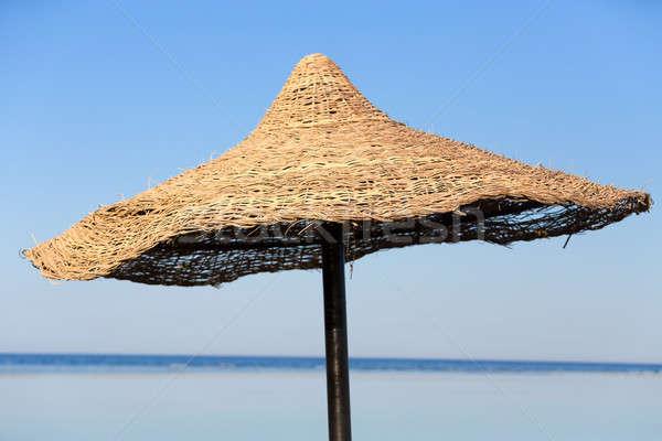 Beach umbrella and blue sky background Stock photo © artush