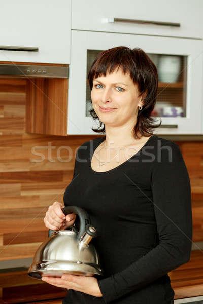 middle-aged woman preparing coffee Stock photo © artush