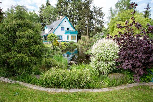 Beautiful house in spring garden Stock photo © artush