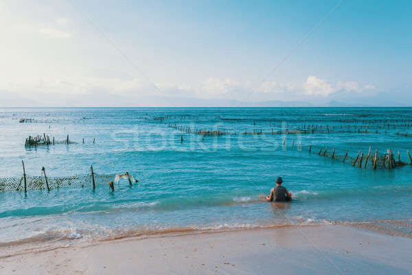 Stock photo: Dream beach, Algae at low tide and boy