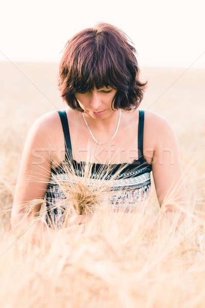 Middle aged beauty woman in barley field Stock photo © artush