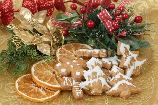 christmas background with needles. orange slices and gingerbreads Stock photo © artush