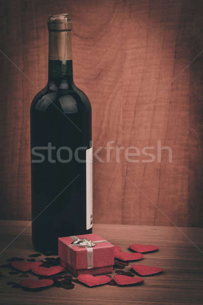 bottle of vine, red hearts and small present a retro style Stock photo © artush