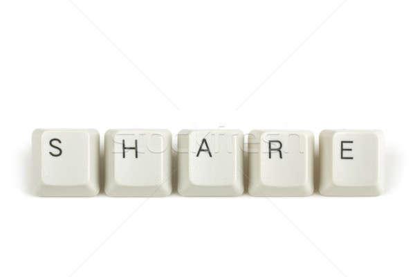 share from scattered keyboard keys on white Stock photo © artush