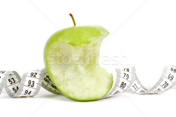 Green bitten apple isolated on white with measuring tape Stock photo © artush