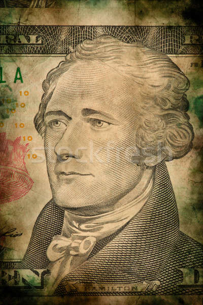 Macro of Alexander Hamilton on ten USA dollar banknote grunge vintage style Stock photo © artush