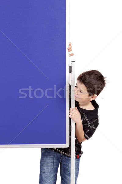 Portrait of happy little boy with blue blank board Stock photo © artush