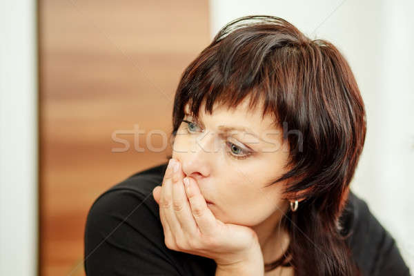 tired woman holding head, looking out Stock photo © artush