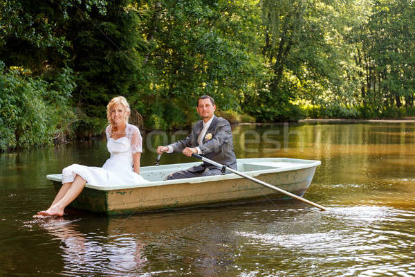 Young just married bride and groom on boat Stock photo © artush