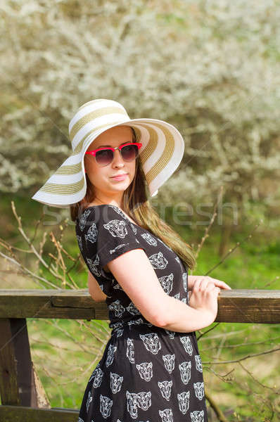 cheerful fashionable woman with hat Stock photo © artush