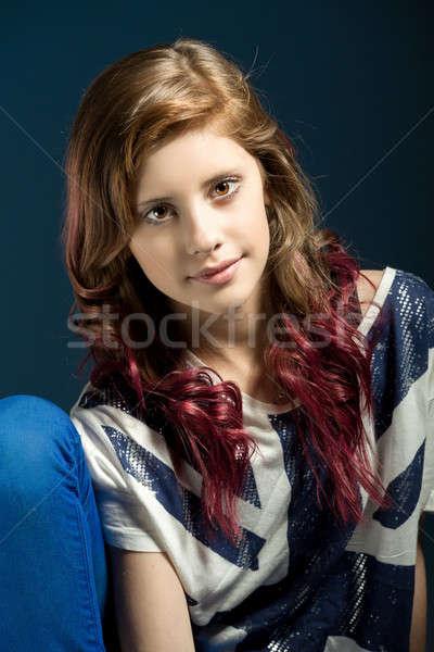 sitting fashion portrait of young beautiful girl Stock photo © artush