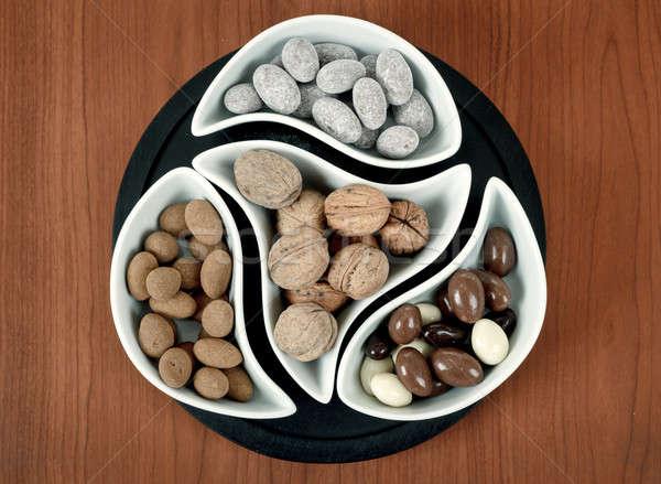 almonds in chocolate and walnuts Stock photo © artush