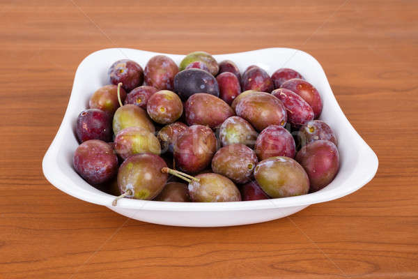 Acid purple and green Plums (Blackthorns)in bowl Stock photo © artush