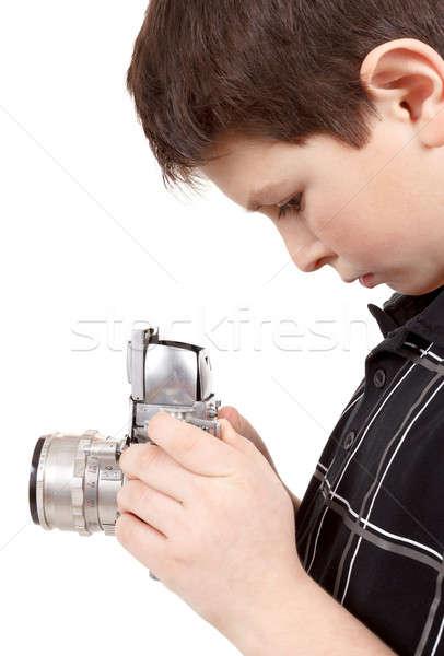 Młody chłopak starych vintage analog kamery patrząc Zdjęcia stock © artush