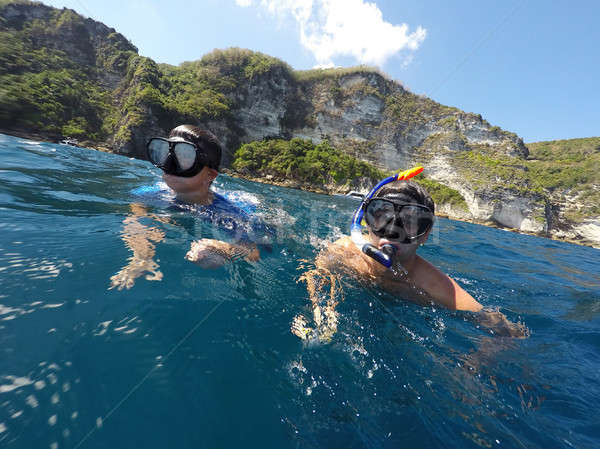 shoot of a young boy snorkeling with father Stock photo © artush