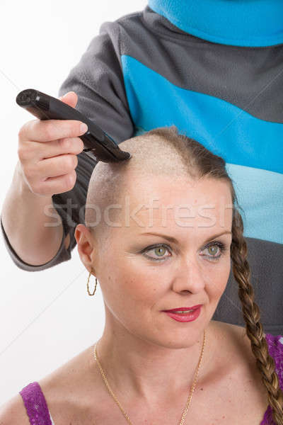 beautiful woman cancer patient shaving hair Stock photo © artush