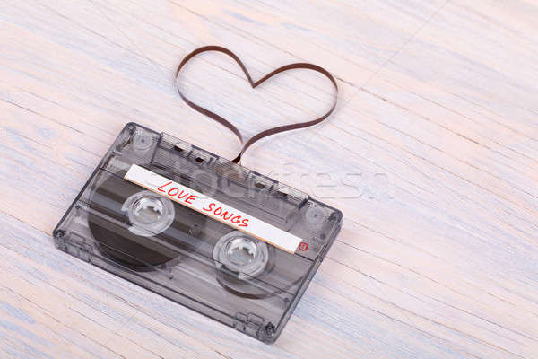 Audio cassette tape on wooden background. audio film shaping hea Stock photo © artush