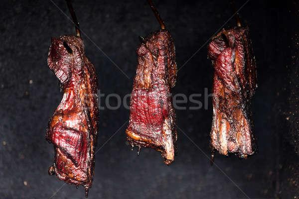 Smoking pork neck in home smokehouse Stock photo © artush