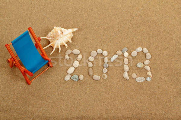 vacation background with sun lounger and text 2013 from stones Stock photo © artush