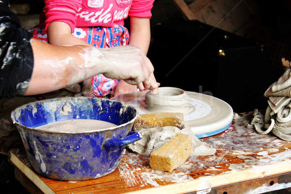 child potter shaping clay in workshop Stock photo © artush