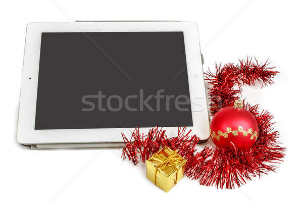 gift white tablet with Christmas ball, box and red chain Stock photo © artush