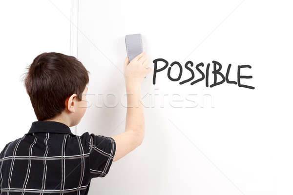 happy little boy erasing text on white board Stock photo © artush