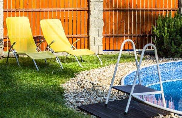 Wenig home Schwimmbad Sonne Blume Gebäude Stock foto © artush